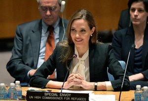 Angelina éembaixadora do Alto Comissariado das Nações Unidas para Refugiados eativista na luta pela igualdade de gêneros e social (AFP/Stan Honda)