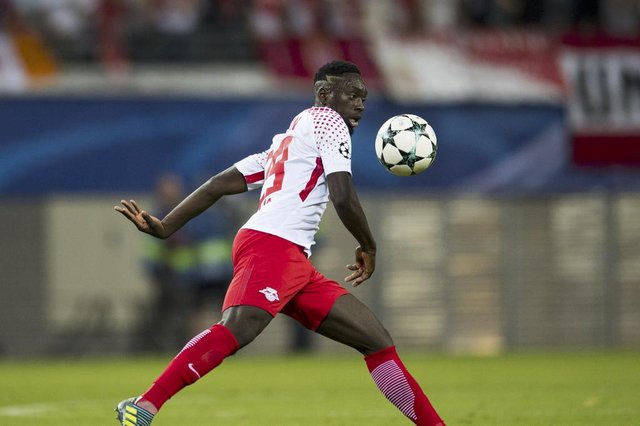 RB Leipzigs forward from France Jean-Kevin Augustin plays the ball during the UEFA Champions League group G football match RB Leipzig v AS Monaco in Leipzig, eastern Germany on September 13, 2017.  / AFP PHOTO / ROBERT MICHAELEditoria: SPOLocal: LeipzigIndexador: ROBERT MICHAELSecao: soccerFonte: AFPFotógrafo: STR