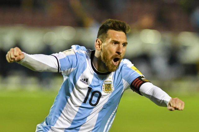 Argentinas Lionel Messi celebrates after scoring against Ecuador during their 2018 World Cup qualifier football match in Quito, on October 10, 2017. / AFP PHOTO / Juan Ruiz