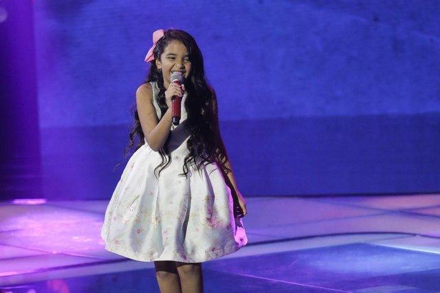 Mariah Yohana, cantando  ¿Uni Duni Tê¿, do Trem da Alegria, no The Voice Kids