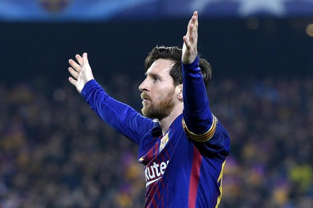 Barcelonas Argentinian forward Lionel Messi celebrates after scoring a goal during the UEFA Champions League round of sixteen second leg football match between FC Barcelona and Chelsea FC at the Camp Nou stadium in Barcelona on March 14, 2018. / AFP PHOTO / LLUIS GENE