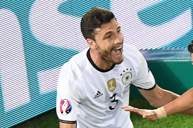 FBL-EURO-2016-MATCH47-GER-ITAGermanys midfielder Mesut –zil (R) celebrates with Germanys defender Jonas Hector after scoring during the Euro 2016 quarter-final football match between Germany and Italy at the Matmut Atlantique stadium in Bordeaux on July 2, 2016. Mehdi Fedouach / AFP,