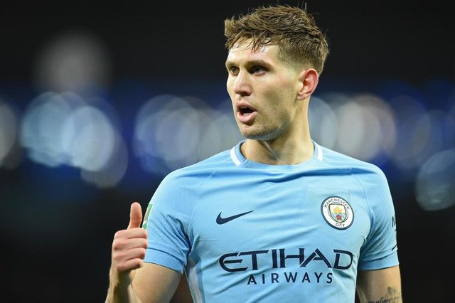 Manchester Citys English defender John Stones gestures during the English League Cup semi-final first leg football match between Manchester City and Bristol City at the Etihad Stadium in Manchester, north west England, on January 9, 2018. / AFP PHOTO / Oli SCARFF / RESTRICTED TO EDITORIAL USE. No use with unauthorized audio, video, data, fixture lists, club/league logos or live services. Online in-match use limited to 75 images, no video emulation. No use in betting, games or single club/league/player publications.  /