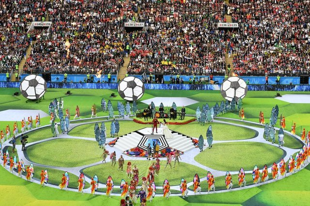 Actors perform during the Opening Ceremony before the Russia 2018 World Cup Group A football match between Russia and Saudi Arabia at the Luzhniki Stadium in Moscow on June 14, 2018. / AFP PHOTO / Mladen ANTONOV / RESTRICTED TO EDITORIAL USE - NO MOBILE PUSH ALERTS/DOWNLOADSEditoria: SPOLocal: MoscowIndexador: MLADEN ANTONOVSecao: soccerFonte: AFPFotógrafo: STF