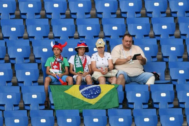 Early fans take their seats prior to the Russia 2018 World Cup Group E football match between Brazil and Switzerland at the Rostov Arena in Rostov-On-Don on June 17, 2018. / AFP PHOTO / KHALED DESOUKI / RESTRICTED TO EDITORIAL USE - NO MOBILE PUSH ALERTS/DOWNLOADSEditoria: SPOLocal: Rostov-on-DonIndexador: KHALED DESOUKISecao: soccerFonte: AFPFotógrafo: STF