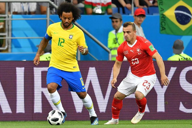 Brazils defender Marcelo (L) controls the ball next to Switzerlands forward Xherdan Shaqiri during the Russia 2018 World Cup Group E football match between Brazil and Switzerland at the Rostov Arena in Rostov-On-Don on June 17, 2018. / AFP PHOTO / JOE KLAMAR / RESTRICTED TO EDITORIAL USE - NO MOBILE PUSH ALERTS/DOWNLOADSEditoria: SPOLocal: Rostov-on-DonIndexador: JOE KLAMARSecao: soccerFonte: AFPFotógrafo: STF