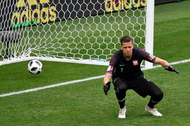 8a61b6eadb7ce The ball goes past Polands goalkeeper Wojciech Szczesny after a shot from  Senegals midfielder Idrissa Gana