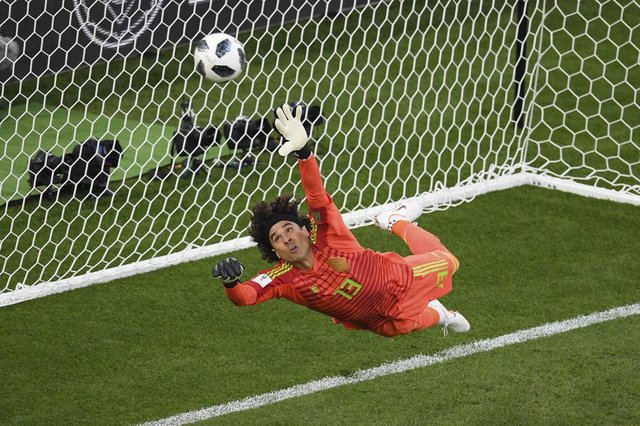 Mexicos goalkeeper Guillermo Ochoa fails to save a penalty during the  Russia 2018 World Cup Group 09443242eaad5
