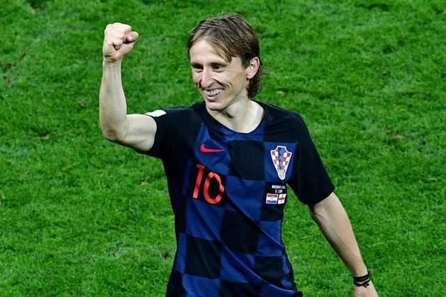 Croatias midfielder Luka Modric celebrates after winning the Russia 2018 World Cup semi-final football match between Croatia and England at the Luzhniki Stadium in Moscow on July 11, 2018. / AFP PHOTO / Mladen ANTONOV / RESTRICTED TO EDITORIAL USE - NO MOBILE PUSH ALERTS/DOWNLOADSEditoria: SPOLocal: MoscowIndexador: MLADEN ANTONOVSecao: soccerFonte: AFPFotógrafo: STF