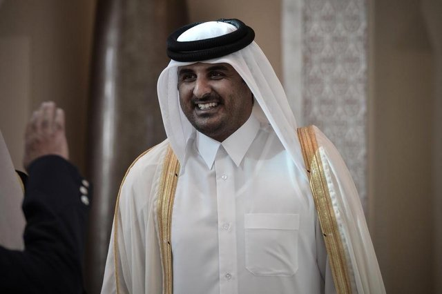 (FILES)- A December 24, 2012, file photo shows Qatari Crown Prince Sheikh Tamim bin Hamad al-Thani smiling as he arrives in the Bahraini capital of Manama, to attend the annual Gulf Cooperation Council (GCC) summit. The Emir of Qatar, Sheikh Hamad bin Khalifa al-Thani, is expected to meet members of the royal family on June 24, 2013, with Qatari officials and diplomats saying a transfer of power to his son, Crown Prince Sheikh Tamim bin Hamad al-Thani, is imminent.  AFP PHOTO / MOHAMMED AL-SHAIKH