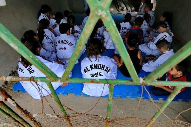 Gravataí , RS . Projeto com aulas gratuitas de Taekwondo. Fotos Júlio Cordeiro