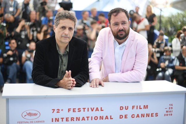 Brazilian film director Kleber Mendonca Filho (L) and Brazilian director Juliano Dornelles pose during a photocall for the film Bacurau at the 72nd edition of the Cannes Film Festival in Cannes, southern France, on May 16, 2019. (Photo by LOIC VENANCE / AFP)