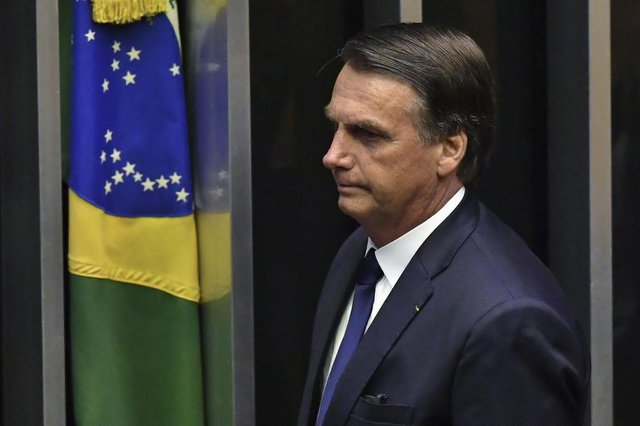Brazils newly sworn-in President Jair Bolsonaro is pictured during his inauguration ceremony, at the Congress in Brasilia on January 1, 2019. - Bolsonaro takes office with promises to radically change the path taken by Latin Americas biggest country by trashing decades of centre-left policies. (Photo by NELSON ALMEIDA / AFP)Editoria: POLLocal: BrasíliaIndexador: NELSON ALMEIDASecao: governmentFonte: AFPFotógrafo: STF