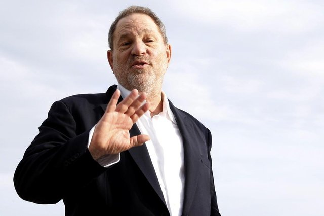 (FILES) This file photo taken on October 5, 2015 shows Harvey Weinstein, US film producer and executive producer of the TV series War and Peace, posing during a photocall at the MIPCOM audiovisual trade fair in Cannes, southeastern France.New York police said on October 12, 2017 they have reopened a investigation into allegations of a 2004 sexual assault by disgraced movie mogul Harvey Weinstein. An avalanche of claims of sexual harassment, assault and rape by the Hollywood heavyweight have surfaced since the publication last week of an explosive New York Times report alleging a history of abusive behavior dating back decades. / AFP PHOTO / VALERY HACHE