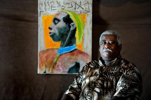 Matéria sobre o dia 20 de novembro - Dia da Consciência Negral Paulo Jorge Amaral Cardoso  ( no centro e sua equipe)- presidente da Associação dos Moradores da Vila Tronco (Amavitron).