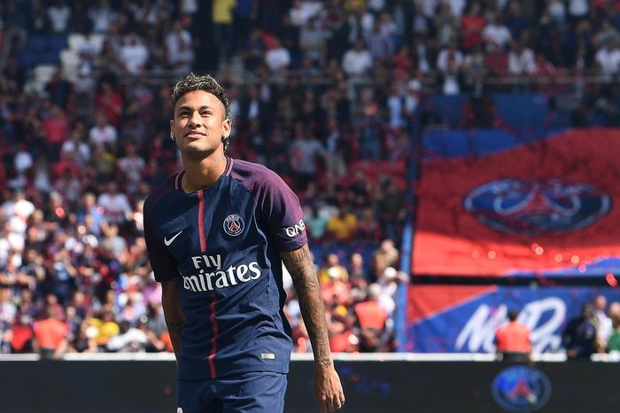 Paris Saint-Germain's Brazilian forward Neymar looks on during his presentation to the fans at the Parc des Princes stadium in Paris on August 5, 2017. Brazil superstar Neymar will watch from the stands as Paris Saint-Germain open their season on August 5, 2017, but the French club have already clawed back around a million euros on their world record investment. Neymar, who signed from Barcelona for a mind-boggling 222 million euros ($264 million), is presented to the PSG support prior to his new team's first game of the Ligue 1 campaign against promoted Amiens.  / AFP PHOTO / ALAIN JOCARD