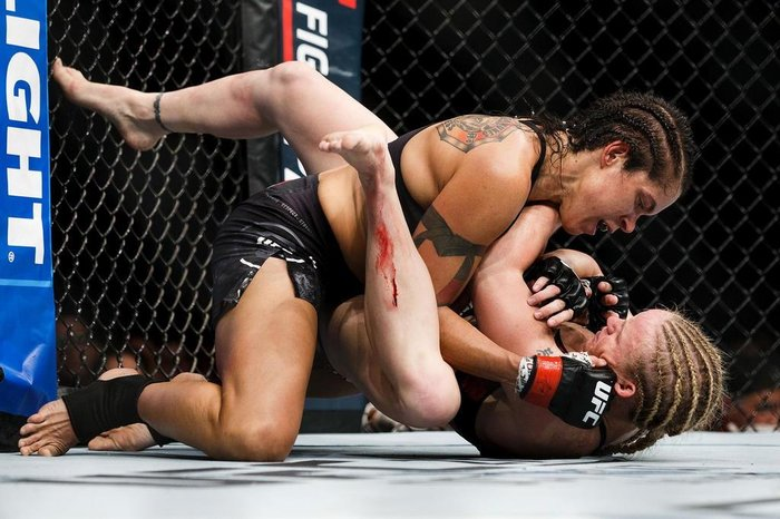 EDMONTON, AB - SEPTEMBER 09: Amanda Nunes, top, fights Valentina Shevchenko during UFC 215 at Rogers Place on September 9, 2017 in Edmonton, Canada.   Codie McLachlan/Getty Images/AFP