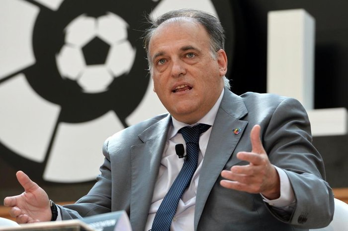 (FILES) This file photo taken on March 23, 2017 shows Javier Tebas, president of La Liga speaking during the official launch of Spanish Football League La Liga office in Singapore. Qatari-owned French side Paris Saint Germain are laughing at the present system of Financial Fair Play (FPP) said a combative , president of La Liga on September 6, 2017.   / AFP PHOTO /