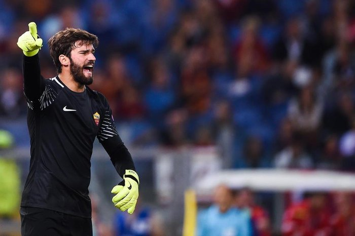 91b506a3eedb6 Romas Brazilian goalkeeper Alisson Ramses Becker shouts instructions during  the UEFA Champions League Group C football
