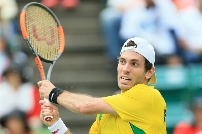Guilherme Clezar of Brazil hits a return to Yuichi Sugita of Japan during the first tennis match of the Davis Cup World Group playoff between Japan and Brazil in Osaka on September 15, 2017.  / AFP PHOTO / JIJI PRESS / STR / Japan OUT