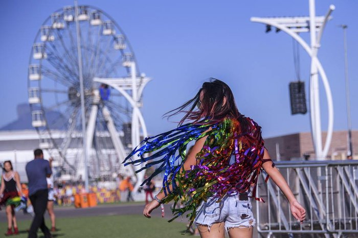 A woman is pictured at the City of Rock on the first day of Rock in Rio, in Rio de Janeiro, Brazil, on September 15, 2017. Running for seven days in all -- Friday through Sunday and then September 21 to 24 -- Rock in Rio is being welcomed by the city as a chance to put the huge facilities built for the 2016 Olympic Games back in use. They have hosted only sporadic events since the Olympics ended in August of that year. While Brazil is only starting to emerge from a painful recession, the 700,000 tickets to the event sold out months ago and city hotels are hoping to be nearly full, reversing a prolonged post-Olympic slump. / AFP PHOTO / Apu Gomes