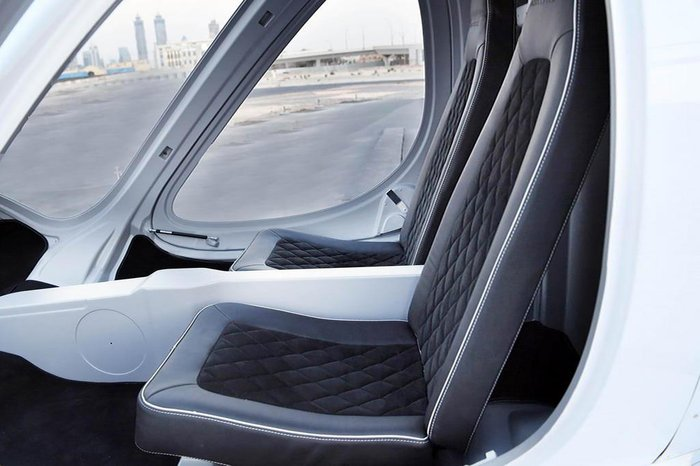 A handout image provided by United Arab Emirates News Agency (WAM) on September 25, 2017 shows the interior of a two-seater hover taxi lying on a helipad after a concept flight in Dubai. Dubai has edged closer to its goal of launching a pioneering hover-taxi service, as a prototype two-seater driverless aircraft, supplied by Germany-based Volocopter, flew on a concept flight without passengers on September 25, 2017. / AFP PHOTO / WAM / Handout / === RESTRICTED TO EDITORIAL USE - MANDATORY CREDIT AFP PHOTO / HO / WAM - NO MARKETING NO ADVERTISING CAMPAIGNS - DISTRIBUTED AS A SERVICE TO CLIENTS ===