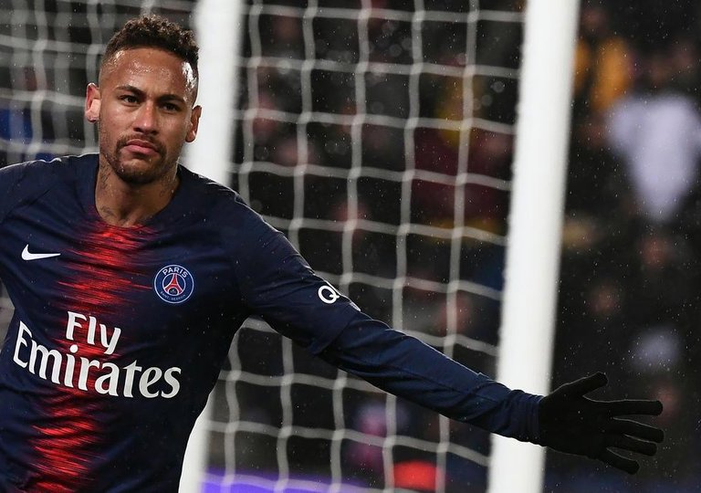 Paris Saint-Germains Brazilian forward Neymar celebrates after scoring a  goal during the French L1 b0d9417dff8c2