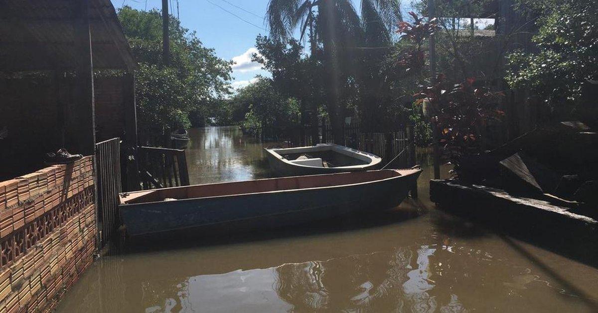 Após enchente, famílias voltam para casa em Triunfo - Zero Hora
